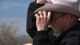 Marshall Larry Cearly, the sheriff of Magdalena, New Mexico, keeps watch.