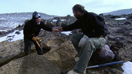 Dr. Allan Ashworth (left) and Dr. Adam Lewis, two geologists, look for fossils in the Dry Valleys of Antarctica