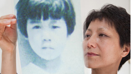 Filmmaker looks at photo of the girl she was switched with when she was adopted.
