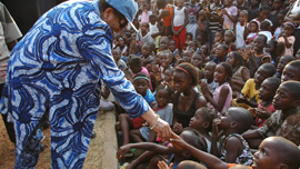 President of Liberia Ellen Johnson Sirleaf in a sea of children