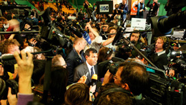 President Mohamed Nasheed is mobbed by the press following his speech at a 350.org rally.