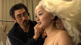 Mezzo-soprano Qian Yi prepares for the stage in her dressing room at the War Memorial Opera House.