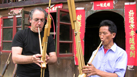 Stewart Wallace learned to play a lusheng from the master lusheng craftsman in the village of Paiya.