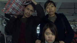 The Zhang family at factory -- their lives represent the lives of millions of Chinese migrant workers.