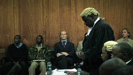 Tom Cholmondeley with defense lawyer Fred Ojiambo