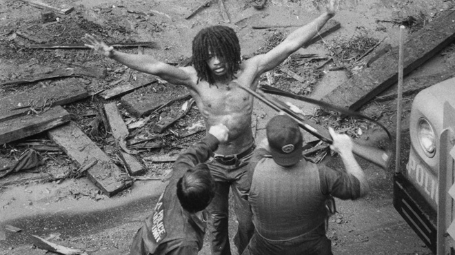 Delbert Africa is arrested by police after the 1978 gun battle.