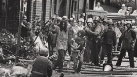 MOVE members exit their headquarters during the 1978 confrontation.