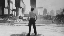 A policeman surveys the devastation on Osage Avenue on May 14, 1985.