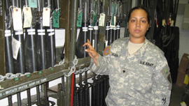 Specialist Rebecca Nava in arms room at Fort Riley, Kansas