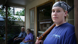 Specialist Shannon Morgan on her parents' porch in Mena, Arkansas