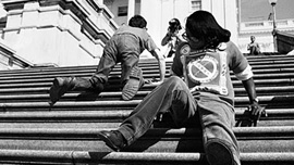 ADAPT protesters climb the steps to the Capitol on March 12th 1990