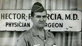 Hector Garcia in front of his medical clinic