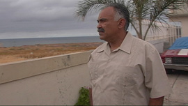 Augie Garcia looks north to the U.S. border from his residence in Tijuana, México