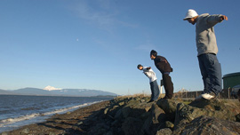Travis Tom, Cody Cayou and Nick Clark on the rocky shores of March Point