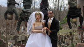 Captain Hogancamp marries Anna in front of the hanging SS who had ravaged Marwencol.