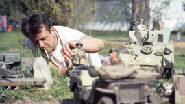 Mark Hogancamp setting up a scene in Marwencol