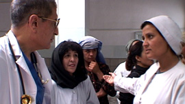 Dr. Mojadidi speaks with Dr. Mina and other hospital staff in the hallways at RBH