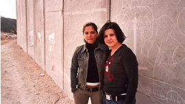 Gal (Israeli, Jewish) and Rezan (Palestinian, Christian) at the wall at Al Zaiem