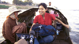 Socheata Poeuv on Mekong River in Cambodia with local fisherwoman