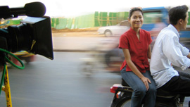 Socheata Poeuv on a moto in Phnom Pen