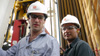 David Poritz (left) and Hugo Lucitante visit a Petroamanas oil field in Ecuador.