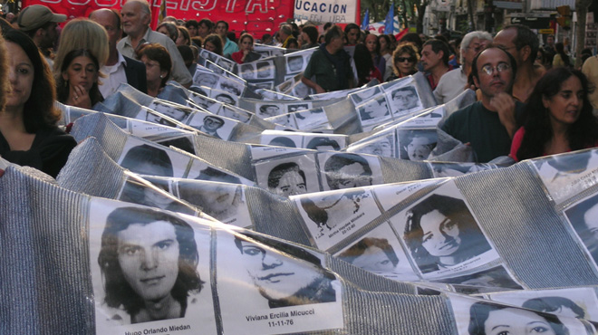 Banner with pictures of the disappeared carried by relatives on the anniversary of the military coup