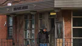 Man standing in front of 3050 Park Avenue in the South Bronx