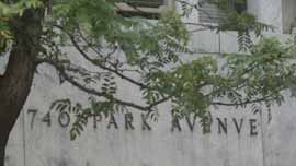 740 Park Avenue façade obscured by tree branches