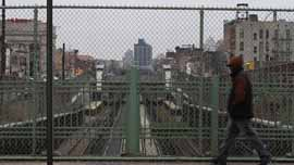 A man walks by sunken train tracks on Park Avenue in the South Bronx
