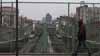 A man walks by sunken train tracks on Park Avenue in the South Bronx