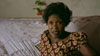 Betty Bigombe sitting on her couch