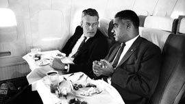 Whitney Young on a plane with a businessman 