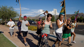 Students and community members participate in a traditional ceremonial run from Tucson to Phoenix