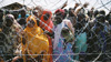 Somalian refugees wave at Kakuma Refugee Camp, Kenya