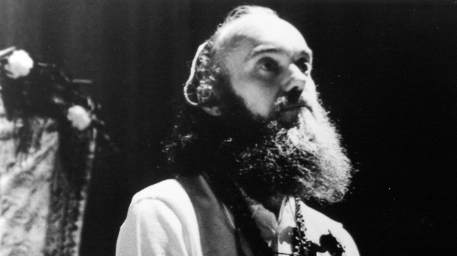 Ram Dass with a tambura, an Indian drone instrument, circa 1968