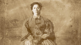 Loreta Velazquez (Romi Dias) poses for a portrait, dressed as a woman, played by Romi Diaz
