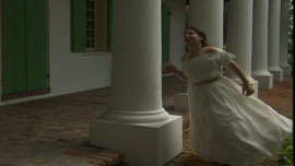 Young Loreta, played by Isabel Taysin Carter, runs through columns in her Cuban plantation home