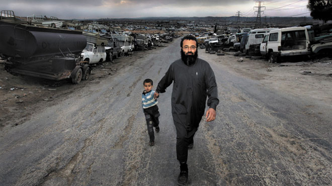 Abu Amar al Azzam with his son Abu Bakr al Azzam in Zarqa, Jordan's second largest city.