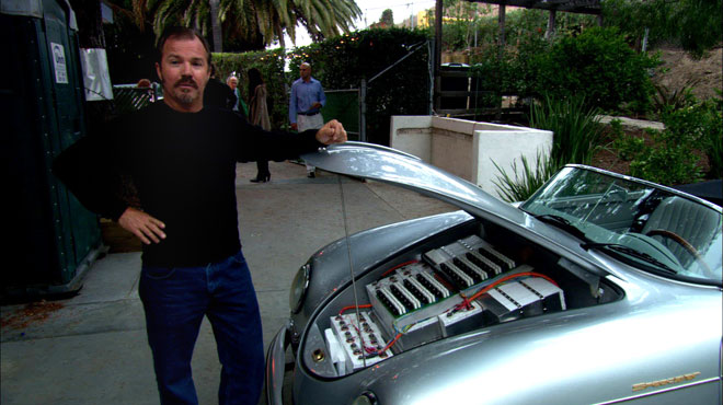 "Greg ""Gadget"" Abbott showing the batteries in his converted car"