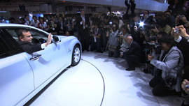 Carlos Ghosn in a Nissan LEAF at a press event