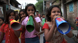 Child activists working with Amlan, marching through the streets of Kolkata using megaphones to spread health messages