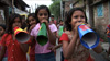 Child activists working with Amlan, marching through the streets of Calcutta using megaphones to spread health messages