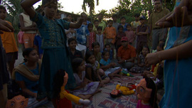 Amlan and the children putting on a puppetshow about the need for clean water in their neighborhood