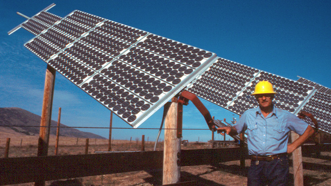 Solar pioneer Bob Stern at the solar panels on his California ranch