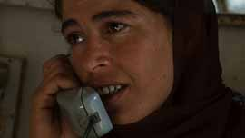 Rafea at Barefoot College talking on the phone with her husband Alian