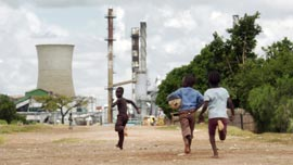 Children playing near a Zambian smelter
