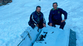 "Adolfo ""Fito"" Strauch and Gustavo Zerbino near the plane's wing"