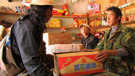Locho negotiates with a Chinese shopkeeper