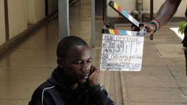 "Wayan Mwita, aka ""Oli,"" shooting a scene in The Team"