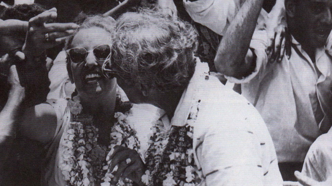 Janet and Cheddi Jagan in a victory parade celebration, 1961